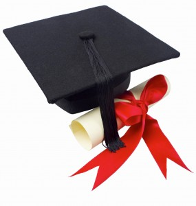 Graduation papers and a graduation hat