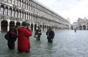 People standing in water in Venice